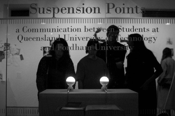 "Alexander Jahani, FCLC '15, uses LED light bulbs in the exhibition ""Suspension Points."" (Jason Boit / The Observer)"