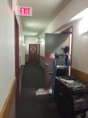 Around 2 p.m., the door of the garbage room on the 10th floor was being painted. (PHOTO BY CECILE NEIDIG/THE OBSERVER)