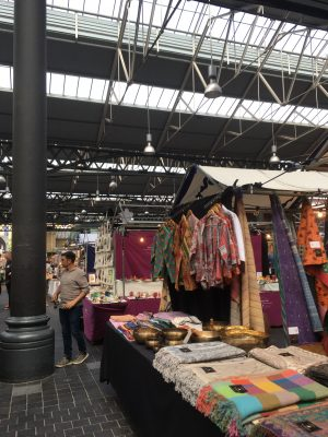 The merchants at Spitalfield Market sell an array of colorful clothing and decor items. (NADINE SANTORO/THE OBSERVER)