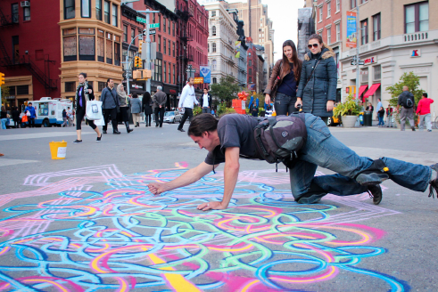 New York City accepts graffiti art onto its scenery; on buildings, walls, subways and sidewalks. Above, an artist works on the streets near Union Square to give a little color to the gray streets of New York. For this photo feature, Observer photographers documented the colorful graffiti world that lives inside the city. (Weiyu Li/The Observer)