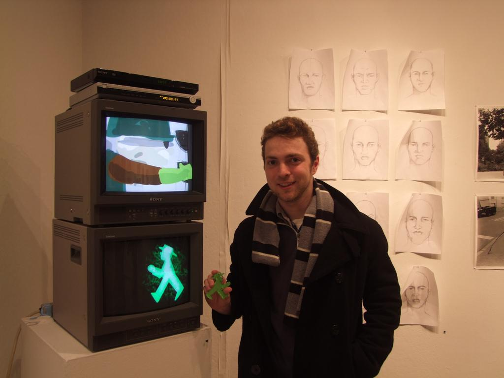 Tim Leuke, FCLC '13, with his work in the senior exhibition in the main gallery. (Ludovica Martella/The Observer)
