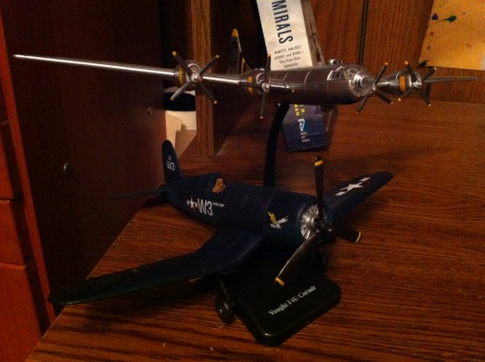 The Vought F4U Corsair, a fighter aircraft, and the B-29 Superfortress, a heavy bomber, two of my many collectable WWII toy airplanes. (Paulina Tam/The Observer)
