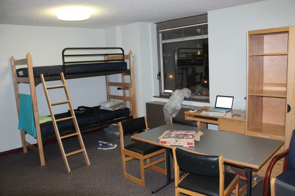 The living room of the faculty-in-residence apartment on the 4th floor of McMahon Hall has been converted into a bedroom to properly accommodated for all residents relocated from 4H. (Tyler Martins/The Observer)