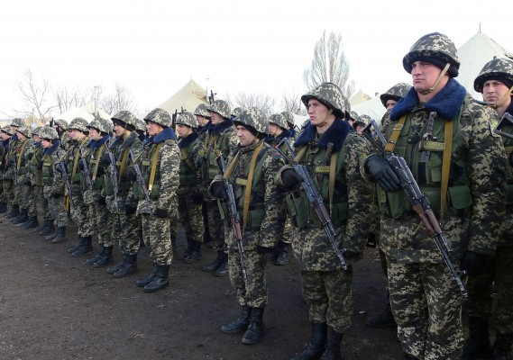 Ukrainian reservists line up for photographers at newly established base near the Russian border.  (Roy Gutman/MCT)