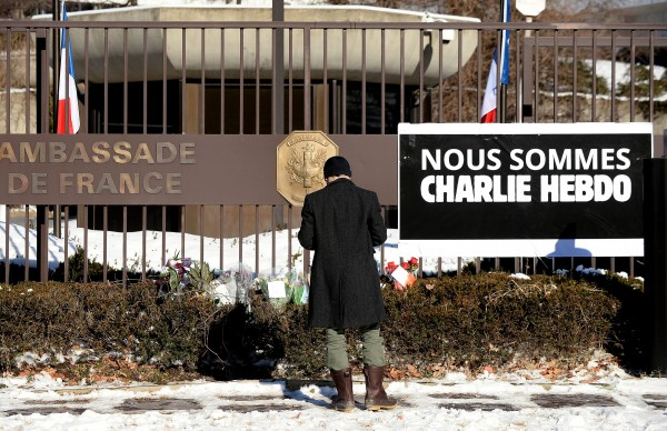 """On January 8, 2015, """"We are Charlie Hebdo"""" hung over the fence at the French Embassy. (Olivier Douliery/Abaca Press/TNS)"""