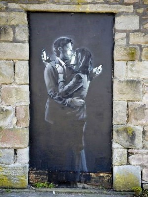 Mobile Lovers by Banksy (PHOTO COURTESY OF THE INDEPENDENT)