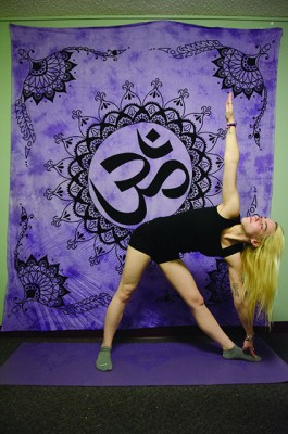 The triangle pose strengthens your overall body. (PHOTO ILLUSTRATION BY ANDRONIKA ZIMMERMAN/ THE OBSERVER)