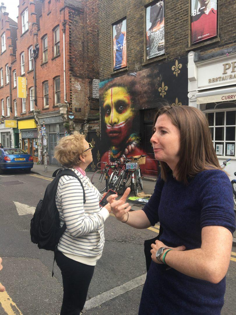 Professor Stone can be seen admiring some of the street art on the tour of Shoreditch. (DEIRDRE MCGRATH/ THE OBSERVER)